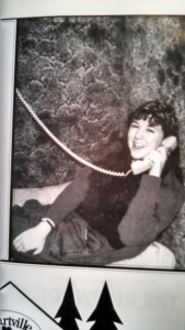 Everything about this picture dates me. I am talking on a landline phone, wearing a wrist watch.