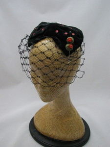 It's a cocktail hat...with a martini olive pin!