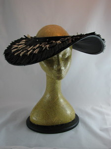 A glamorous crownless hat, with hand-tied fringe.
