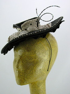 "A wide brimmed cocktail hat with ruffles, inspired by Dior's ""New Look."""