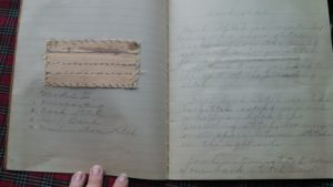 Each page has an example of her work glued on one page, and a description or definition of the technique on the facing page.