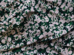 Black, green, and white print fabric.