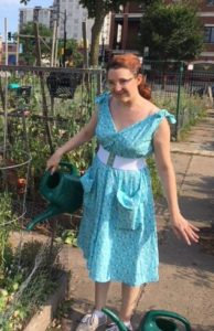 Megan watering plants wearing popover dress