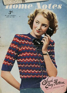 A copy of Home Notes with a young woman using the telephone on the cover, looking very 1940s, wearing a sweater with elbow-length sleeves and a red, white, and blue ripple lace pattern.