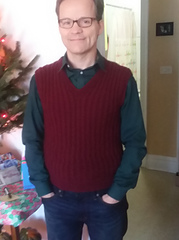 Bob wearing a burgundy cabled sweater vest.